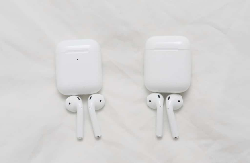 Apple AirPods (2019) on the left with AirPods (2017) on the right