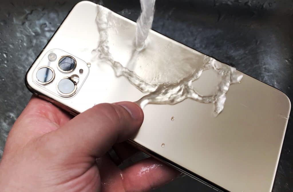 Washing an iPhone 11 Pro Max under a tap