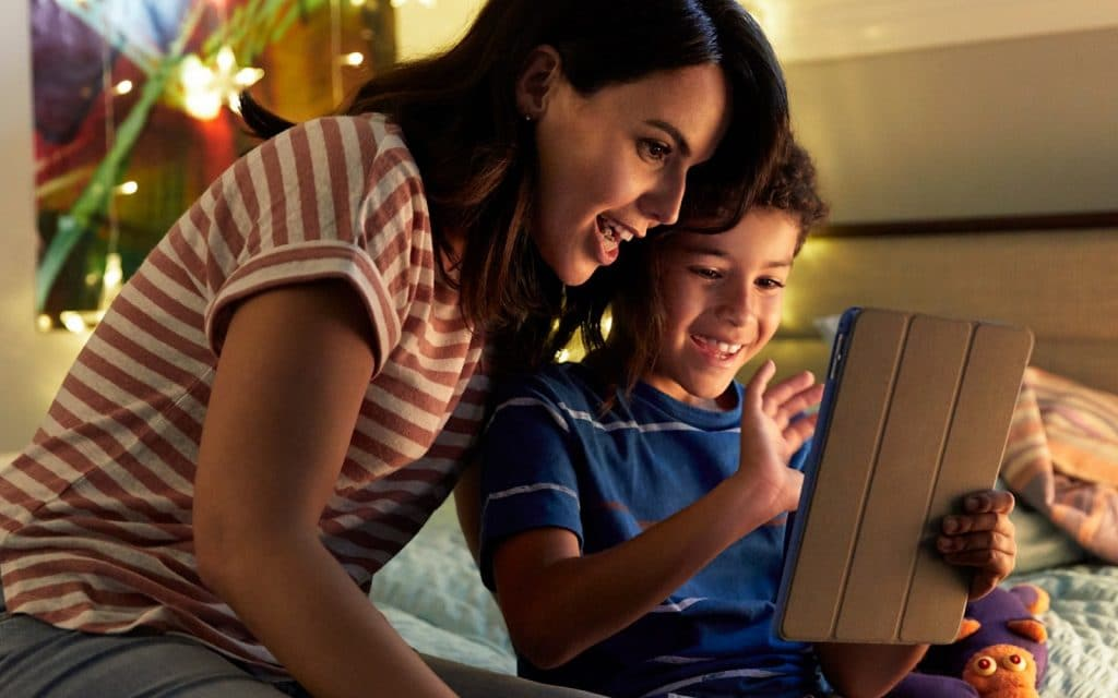 Parent and child using a tablet