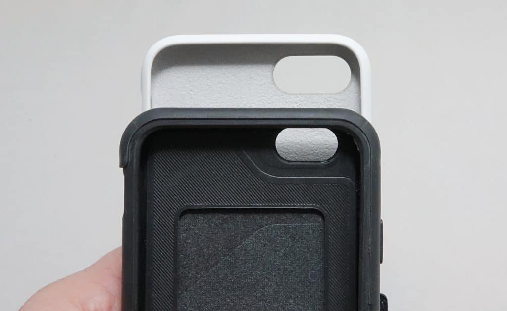 An iPhone SE 2020 case (top) above an older iPhone 6 or 7 case (bottom)