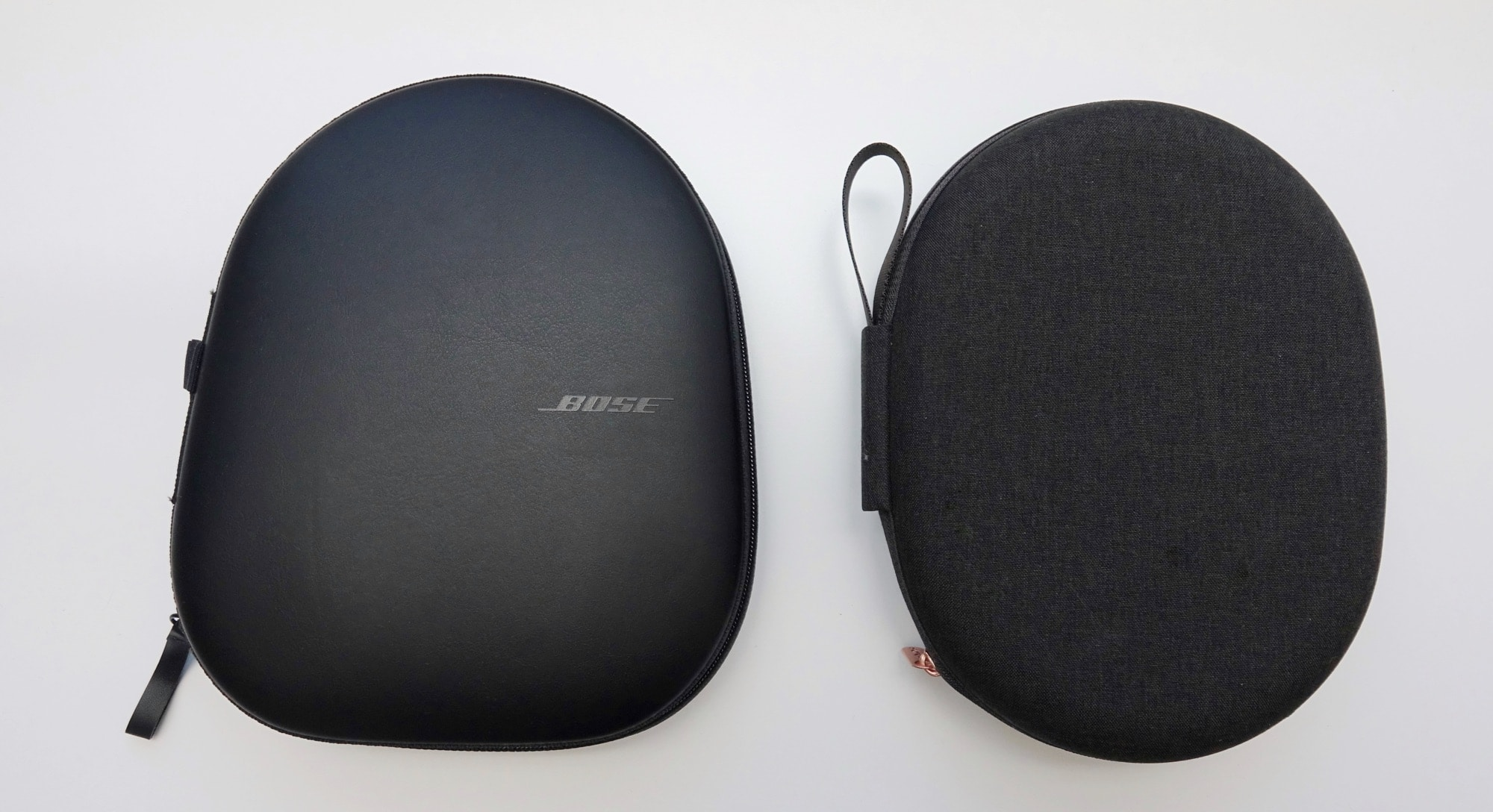 The cases for the Bose 700 and Sony WH-1000XM4, left and right, respectively.