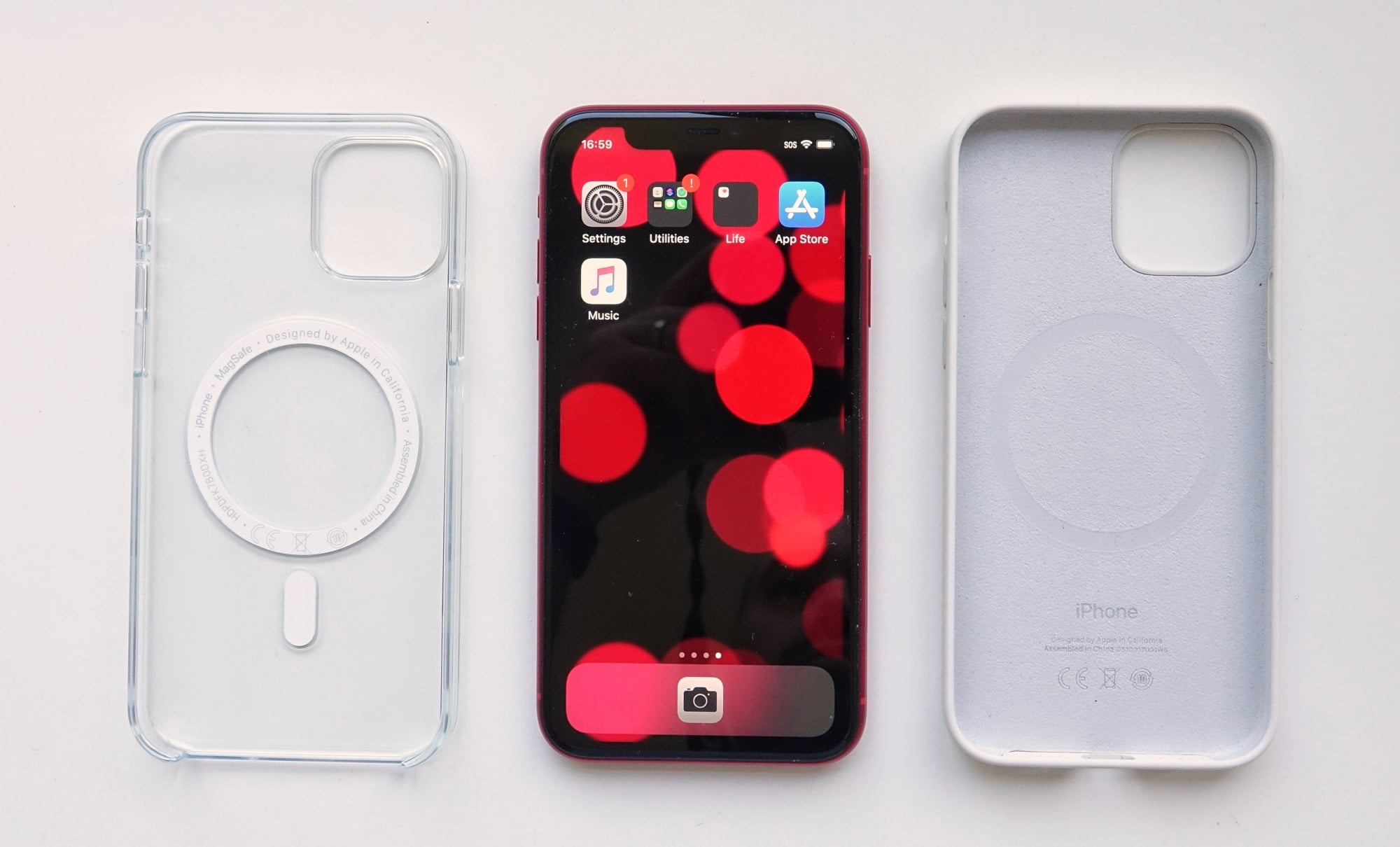 An iPhone 11 next to iPhone 12 cases.