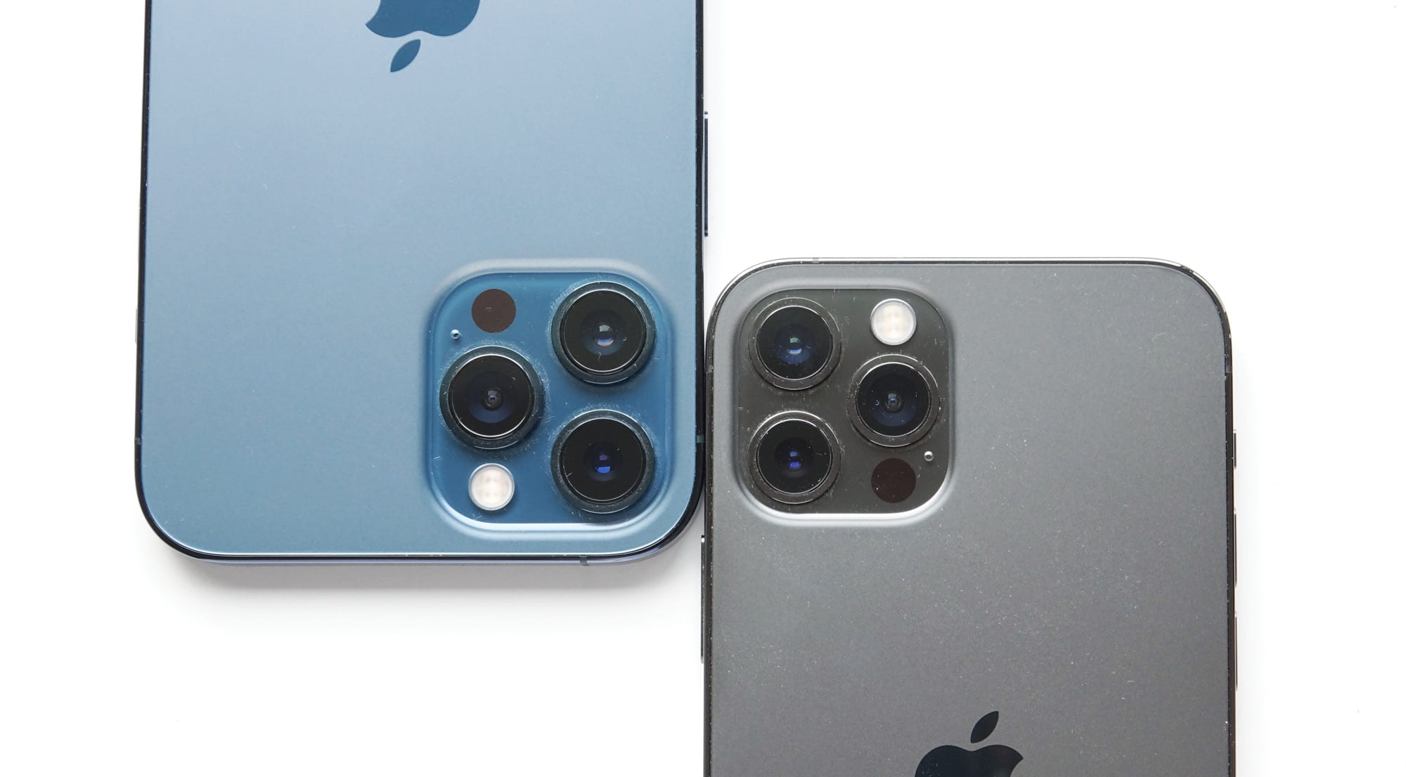 The cameras on the iPhone 12 Pro Max (left) and the iPhone 12 Pro (right)