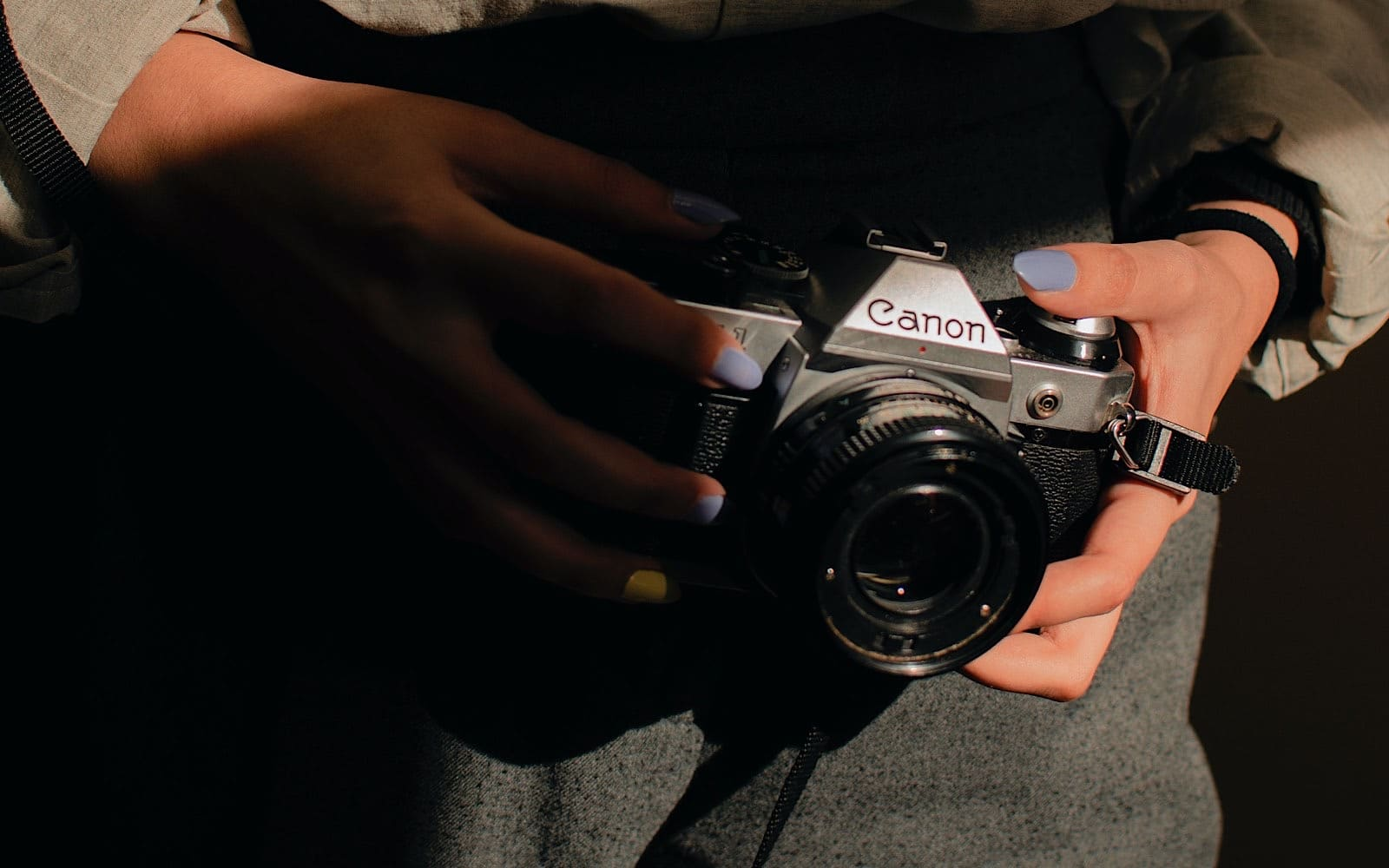 Holding a camera by the sides might make sense, but it's not really what you should do.