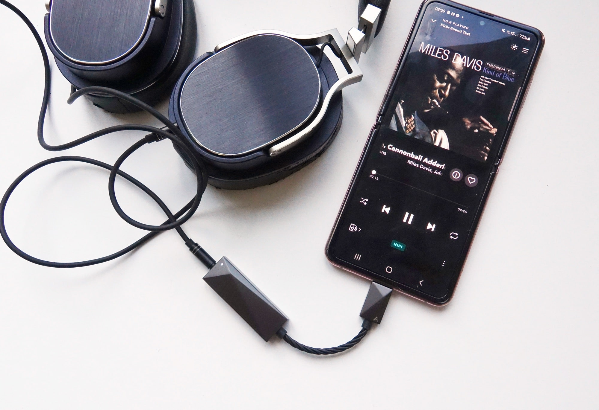 The Astell & Kern DAC Type C Cable plugged into the Galaxy Z Flip and Oppo PM-3
