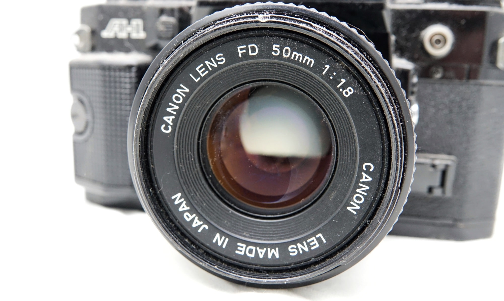 An old Canon low-light 50mm F1.8 on a Canon A1 film camera