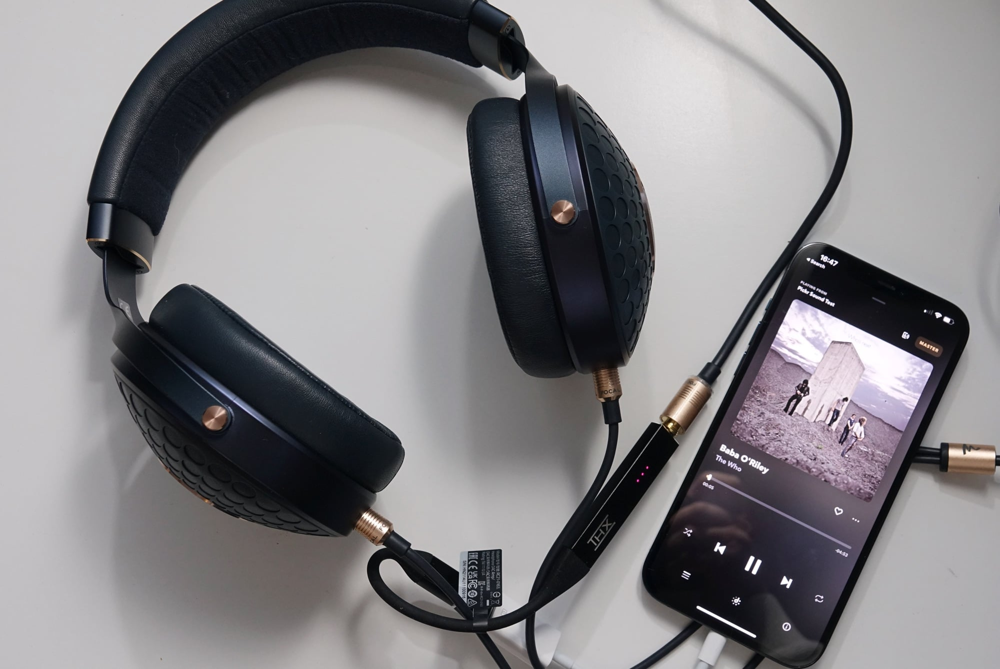 Focal Celestee headphones plugged into the THX Onyx USB DAC and into an iPhone 12 Pro Max