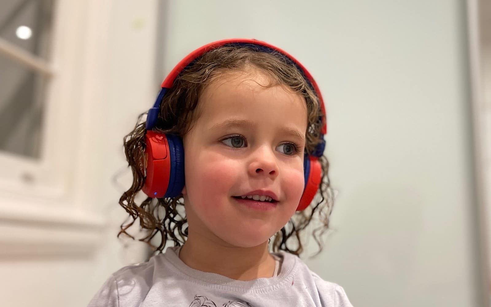 The little one wearing the JBL JR310BT headphones.