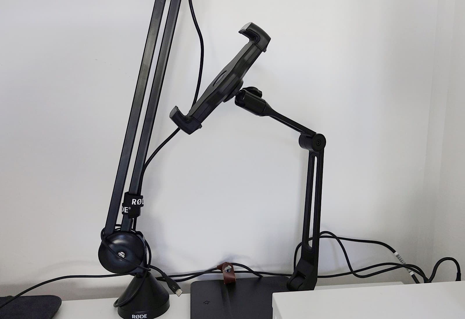 The HoverBar Duo is basically a boom arm with a device clamp.