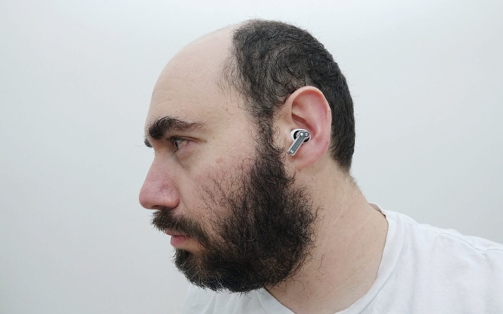 Wearing the Nothing Ear 1 earphones.