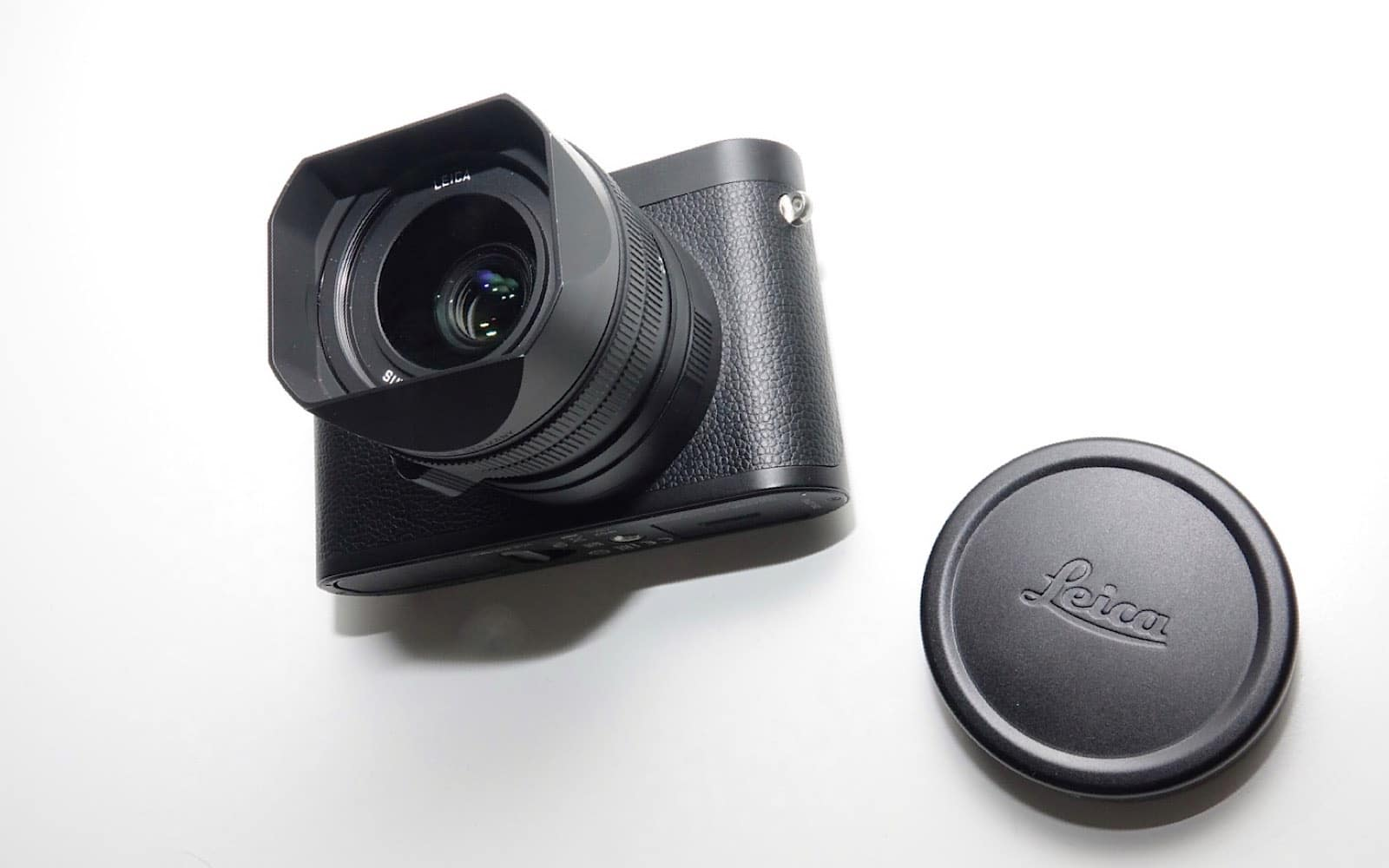 The Leica Q2 Monochrom and its metal lens cap.