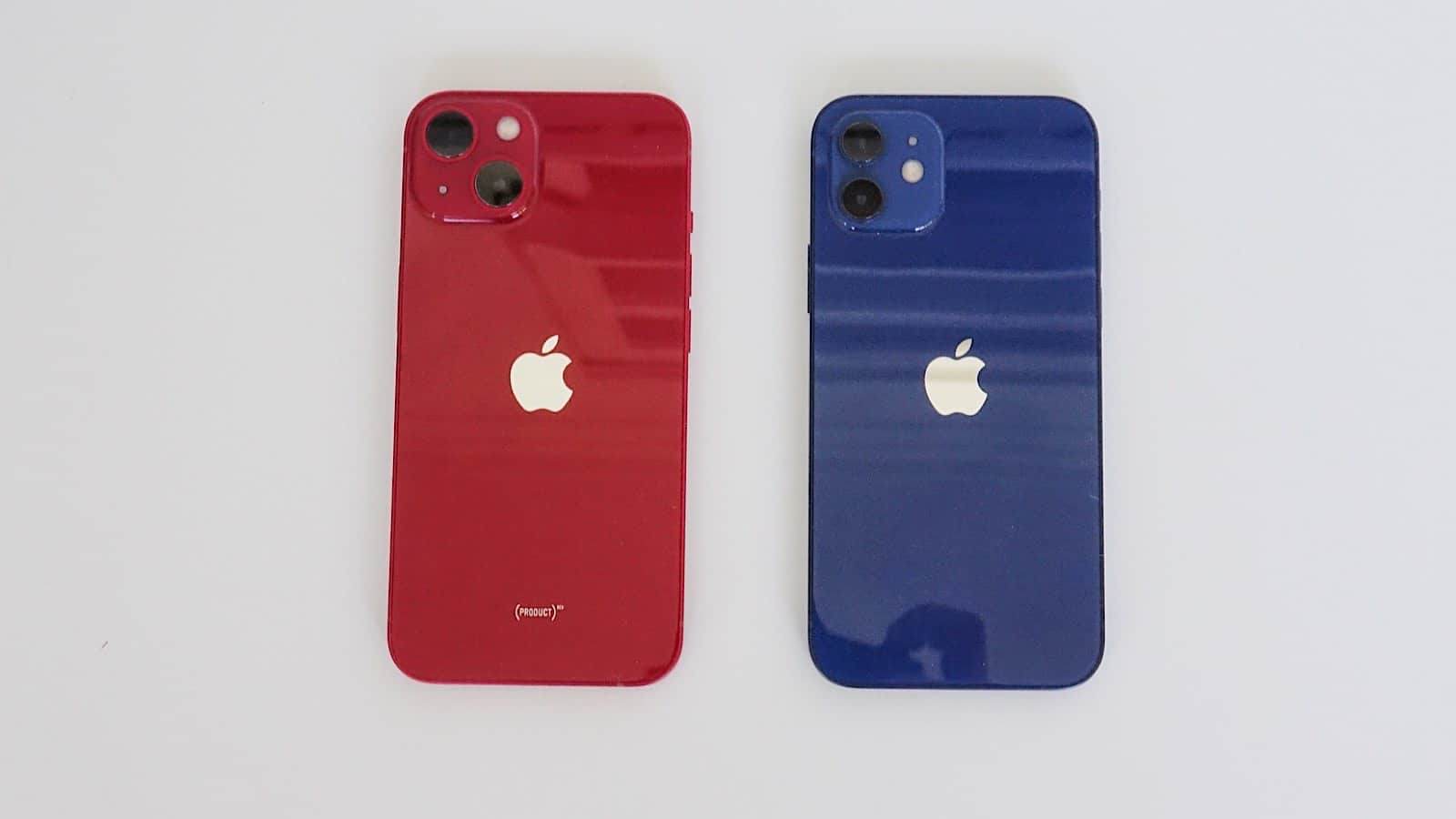The difference in design is visible when comparing the iPhone 13 (left) to the iPhone 12 (right).