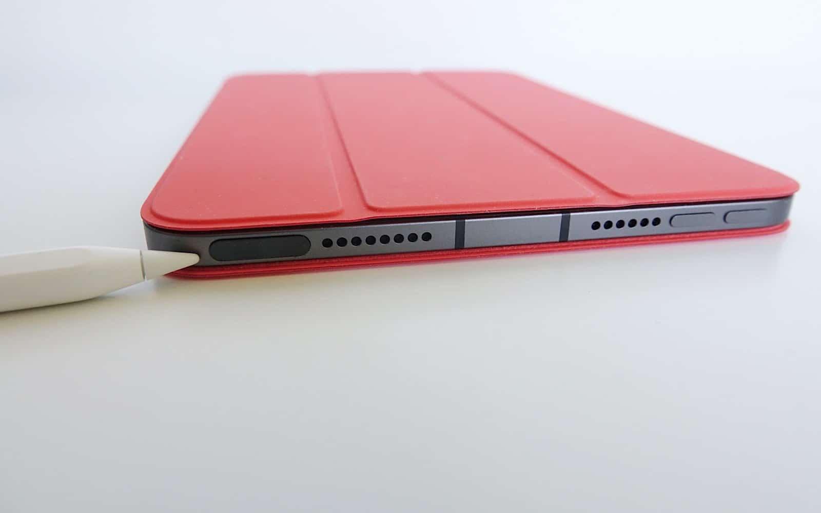 The Apple Pencil points to the fingerprint sensor on the iPad Mini.