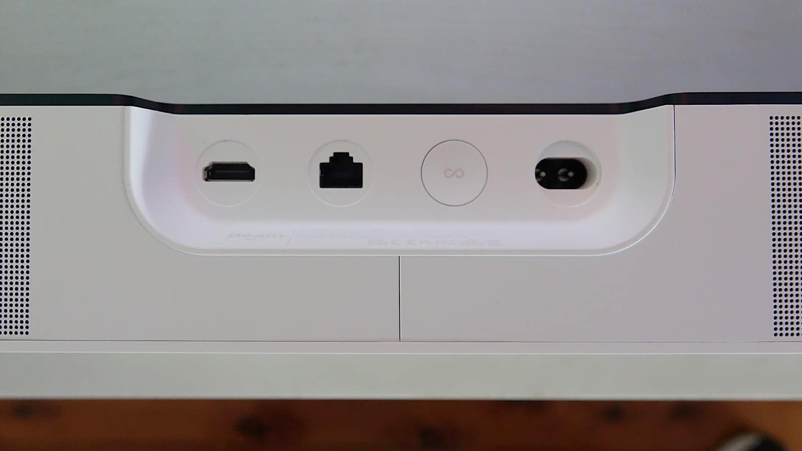 The rear ports on the Sonos Beam Gen 2 include HDMI, Ethernet, and a figure-eight power connector, plus a sync button.