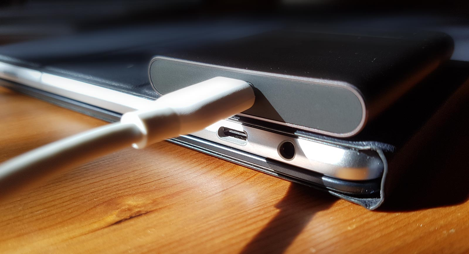 Both the hard drive and the tablet beneath rely on the same USB Type C port technology.